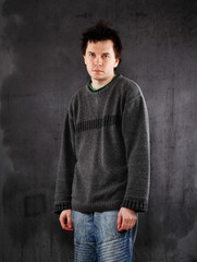 Man in grey sweater.
