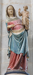 Mechelen - carved and polychrome statue of gothic Madonna