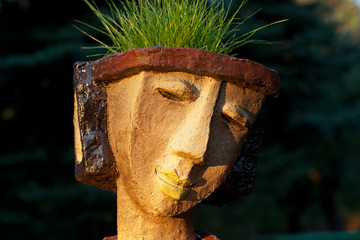 the flower pot in the form of the feminine head