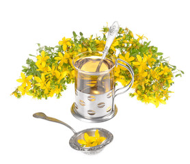 a cup of St. John's tea with fresh flowers on a white background