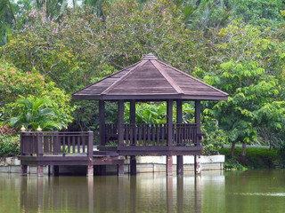 Wooden pier with pavilion in the river