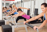 Fotoroleta Women training in the gym