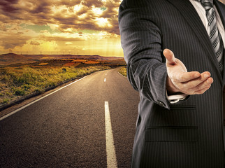 Business man on straight asphalt road greeting new partner