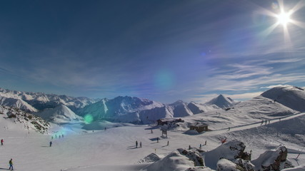 Swiss ski slope and ski lift station lens flare 4K