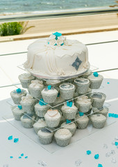 Wedding Cake with Cupcake accompaniment