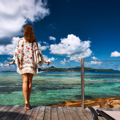 Woman on a beach jetty at Seychelles, La Digue.