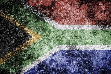 South African flag over a grunge concrete background.