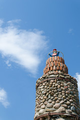 cobblestone lighthouse tower blue sky background