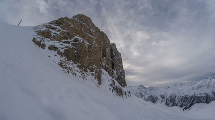 Snow covered Austrain Alps rock wall in winter 4K
