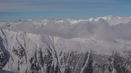 Tirol Alps  Mountain ridges covered in clouds 4K