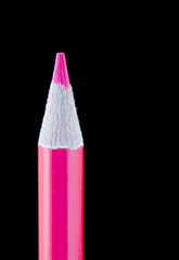 Close up single pink pencil on black