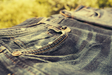 Detail of  beautiful blue jeans, vintage look