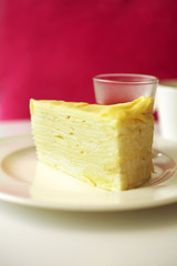 close up crepe cake in white dish