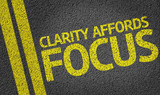 Clarity Affords Focus written on the road poster