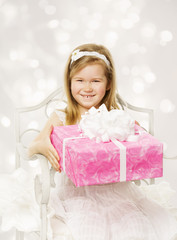 Girl holding birthday present. Happy  child with party gift