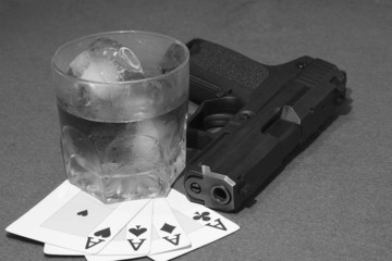 poker hand of aces, card game with drink and a gun ,gangster