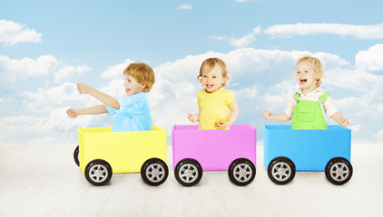 Kids playing toy car. Children passenger sitting in box.