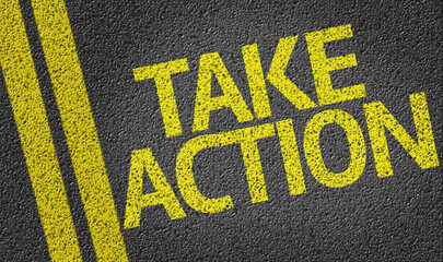 Take Action written on the road