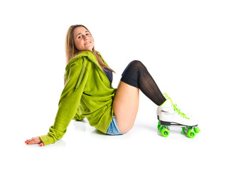Young girl with skates over white background