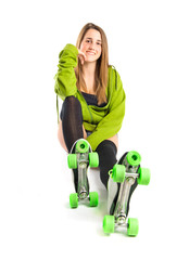 Blonde girl with rollerblade over white background