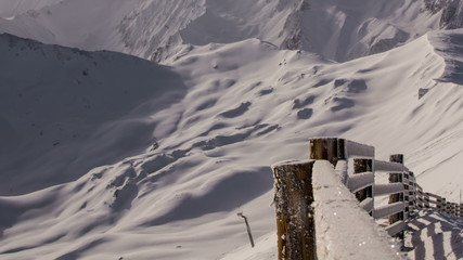 Snow covered fence mountain top time lapse Tirol  4