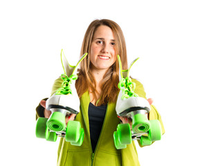 Girl with rollerblade over white background
