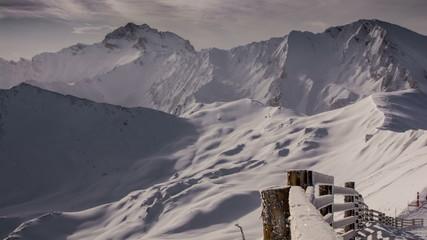 Snow covered fence on mountain top Tirol Ischgl ski resort 4K