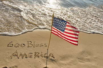 American flag in beach sand