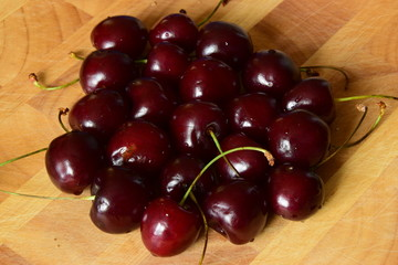 Ripe cherries on a wooden table