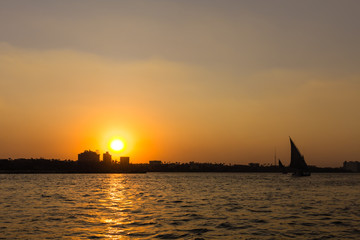 Sunset and Felucca Boat on Nile River , Cairo in Egypt