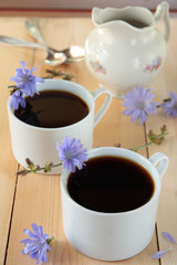 Drink with chicory roots in cups