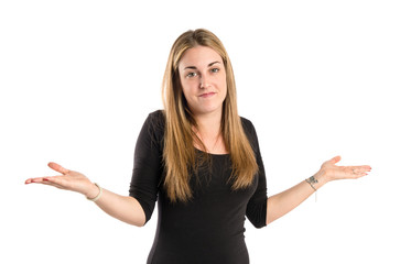 Cute young girl having doubts over isolated white background