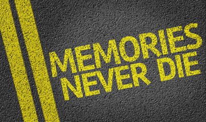 Memories Never Die written on the road