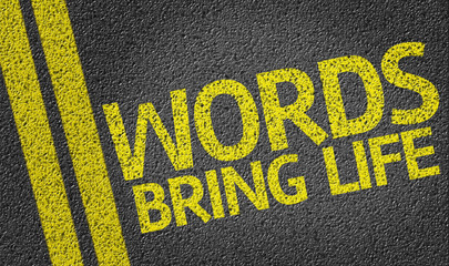 Words Bring Life written on the road