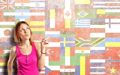 Young girl thinking over flags background