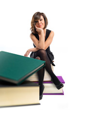 Woman with several books over white background