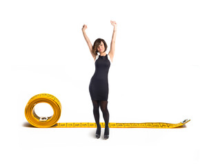 Happy woman with tape measure over white background