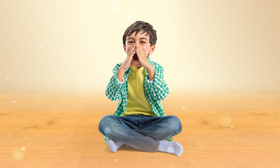 Kid shouting over ocher background