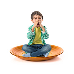 Little kid shouting on ceramic plate