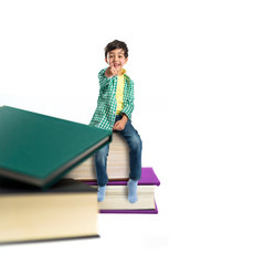 Kid on several books over white background