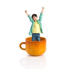 Kid inside ceramic cup over white backgrpund