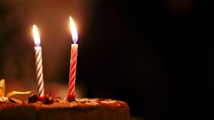 Candles on birthday cake.