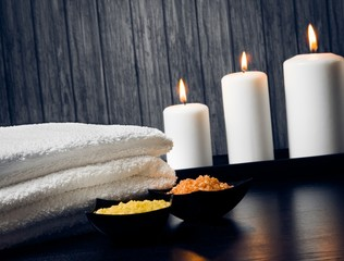 Spa massage border with towel stacked candles sea salt