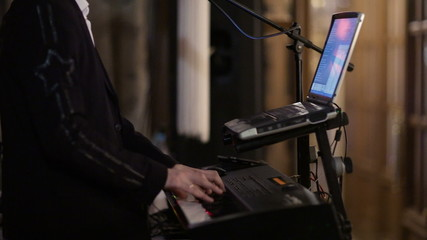 Person playing an electronic keyboard