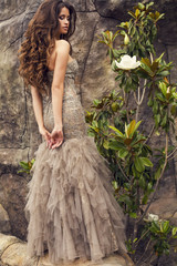 beautiful woman with long curly hair  in luxurious dress