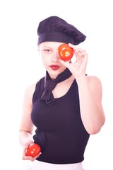 Teen girl in chef hat with tomatoes