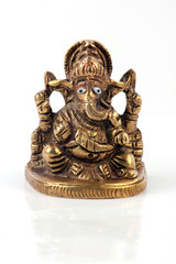 Golden Hindu God Ganesh Isolated On White