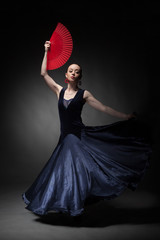 woman dancing flamenco on black