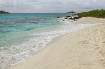View of white sand beach of Gardner bay