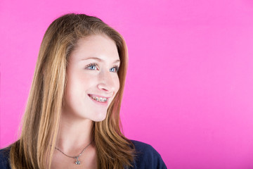 Smiling Beautiful Girl with Braces on Fuchisa Background